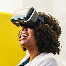 african american woman using VR headset